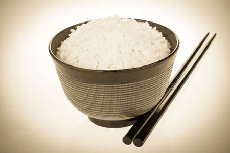 Chopsticks and rice bowl with retro look photo