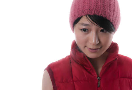 Pretty young asian woman with a red winter jacket and a nice red cap Stock Photo