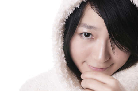 Beautiful young woman in winter outerwear on white Stock Photo
