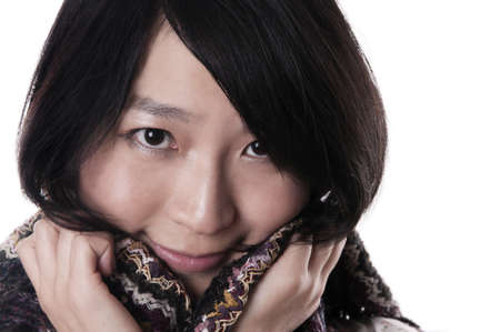 Young asian woman wearing a shawl on white photo