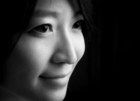 Beautiful eyes and sweet smile of Asian young woman Stock Photo