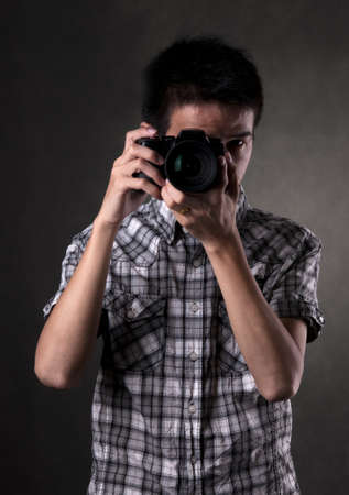 Asian man taking pictures with a slr camera