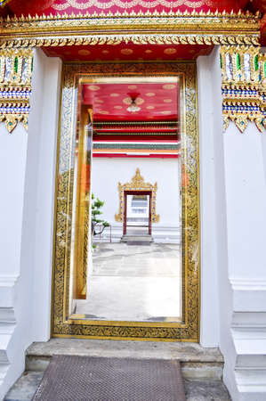 Beautifully decorated doorway entrance to buddhist temple in Thailand