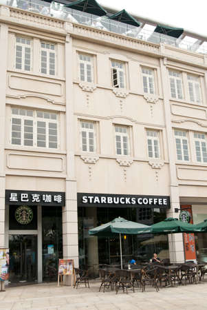 Xiamen, China - September 25:  A new Starbucks coffee shop near the popular tourist destination of Gulangyu opens in the city of Xiamen, China.  Currently it is the largest in all of China.