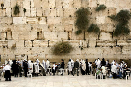 western wall:  Israel, Jerusalem. Western wall.  October, 29th 2008. People pray. A mans half