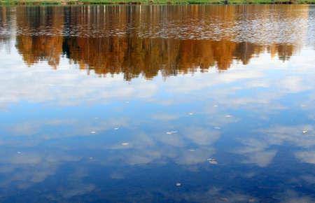 Nature in autumn season. Reflection in lake