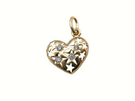 Gold heart by a Vlentines day . Present photo