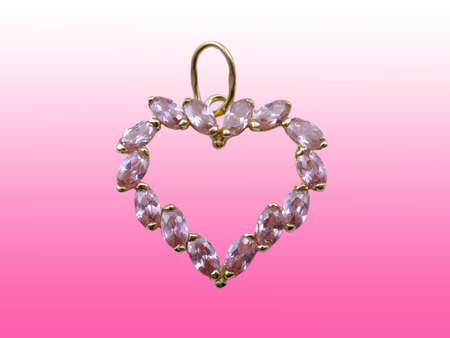 Valentines jewelry heart on pink background photo