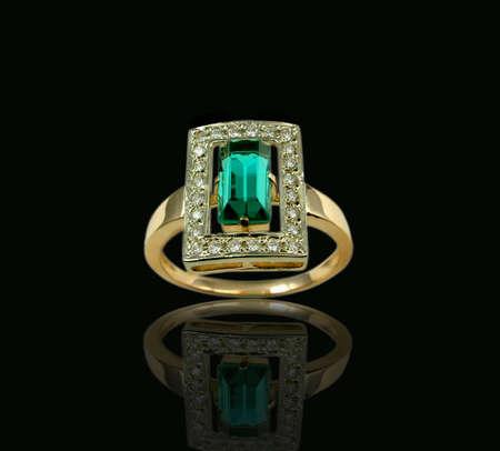 andamp: Golden emerald andamp,amp, diamond ring Stock Photo