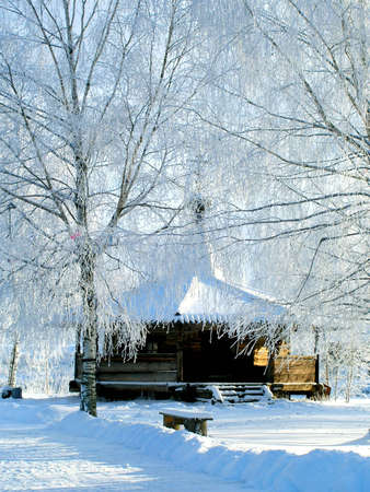 Winter. Old wood chapel photo