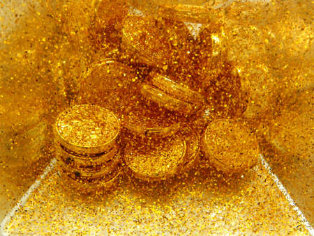 Gold sand and gold coins    photo