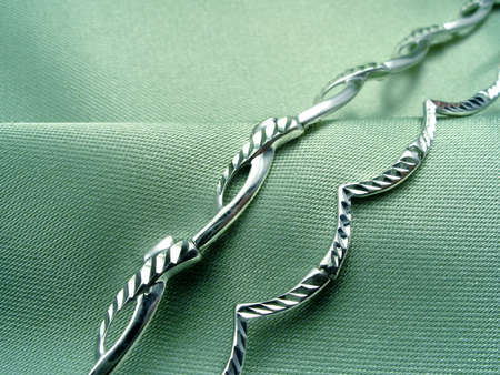 textille: Bracelets on green textille