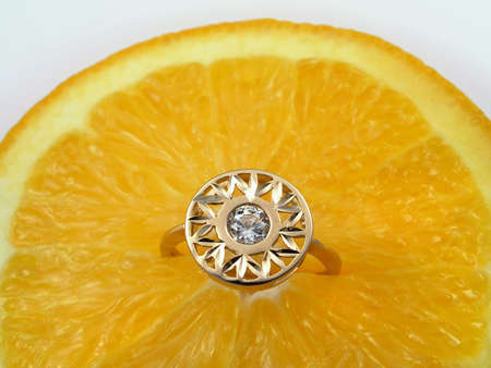Orange background and golden ring with diamond Stock Photo - 864680