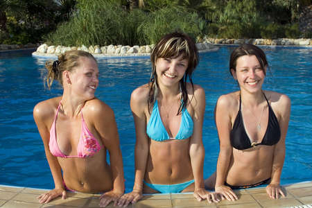 Young beautiful girls in pool Stock Photo - 1180087