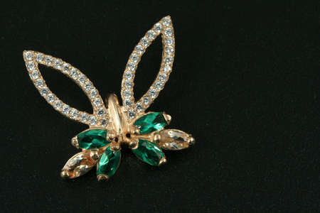 brooch: Jewelry gift. brooch with emerald & brilliants Stock Photo