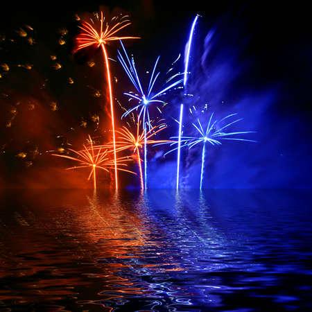 detonation: Celebratory firework. Firework reflection in water Stock Photo