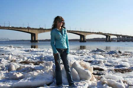 floating bridge:  Spring. River Volga and young woman