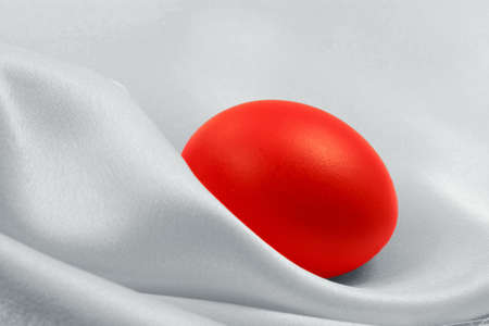 Red egg on white silk background Stock Photo - 2597608