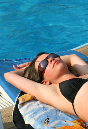 Relax of  young women  in pool photo