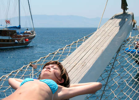 young leave: The girl sunbathes on a yacht