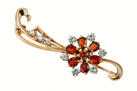 jewelle: Stylish golden brooch with garnet and  brilliants isolated on white