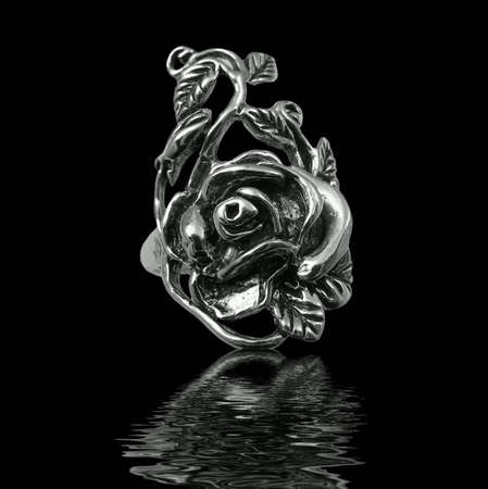 Silver jewelry on black background with water Stock Photo - 3883092