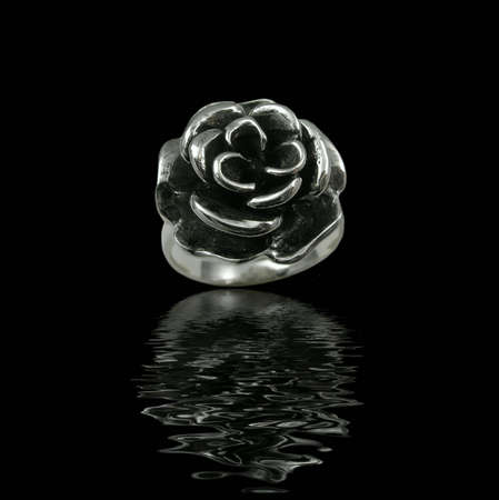 Silver jewelry on black background with water Stock Photo - 3883076