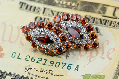 jewelle: Jewlry with garnet and  dollars Stock Photo