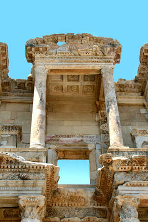 Antiquity greek city - Ephesus. Columns of First Library and blue sky  photo