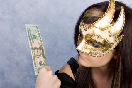 Pretty young woman in Venetian mask with dollars  photo