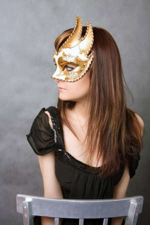 Pretty young woman with Carnival Venetian mask Stock Photo - 4994973