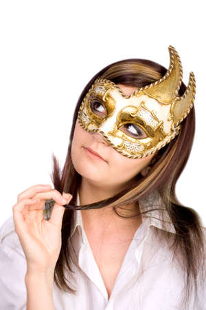 Pretty young woman  with carnival mask isolated on white  photo