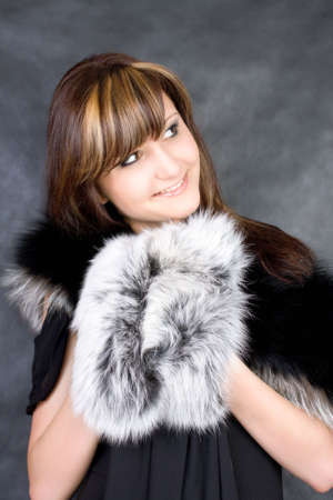 Charming young woman. Fashion studio portrait photo