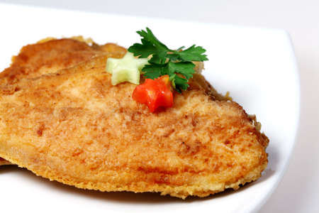 plaice: Roasted  Flounder ( plaice ) on a plate