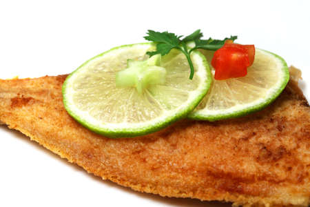 Roasted  Flounder ( plaice ) on a plate with lime Stock Photo
