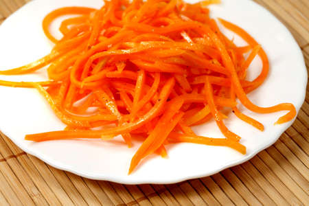 collation:  Salad  Korean carrot  on a plate, cold collation.