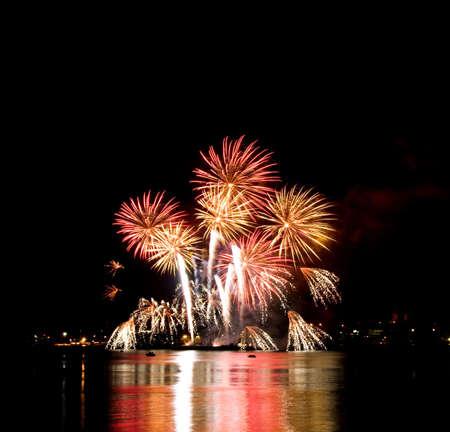 Celebratory bright firework in night sky  photo
