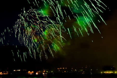 salvoes: Celebratory bright firework in night sky Stock Photo