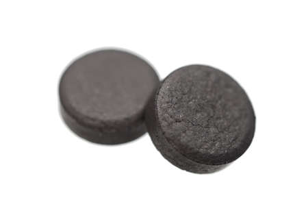 activated: Medical  tablets -  absorbent carbon ( activated carbon, active carbon, activated charcoal ) Stock Photo