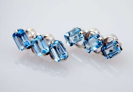 topaz: Silver jewelry with blue topaz isolated on white background