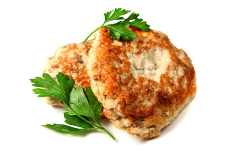 Chicken cutlets with parsley isolated over white background photo