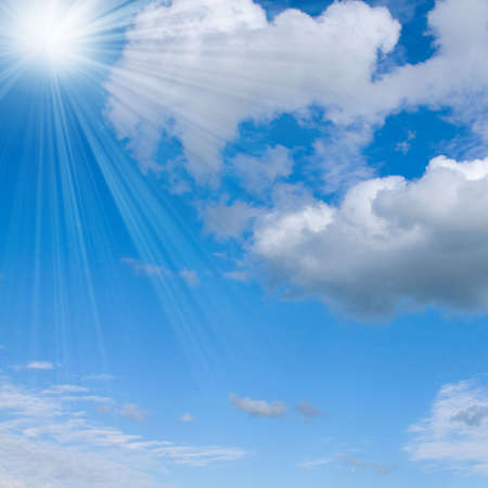 ray: Clouds on a summer sky.  Background for design with sunny rays
