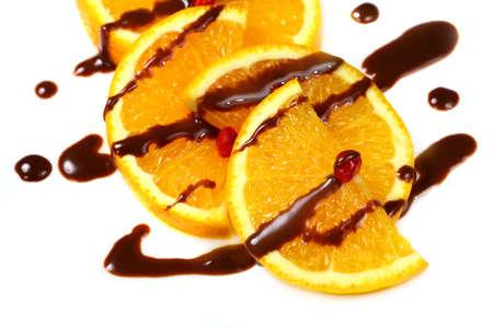 Fruit  orange with  chocolate isolated over white background, macro shot photo