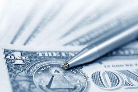 monies: The American money dollars. Bundle of bank notes  and pen