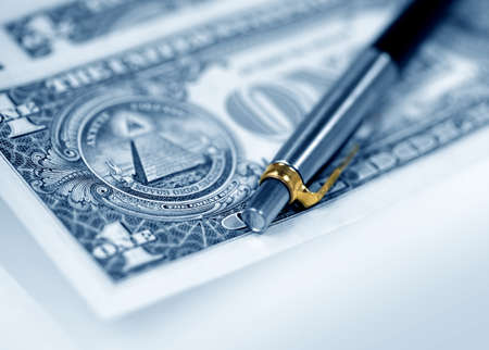 The American money dollars. Bundle of bank notes  and pen Stock Photo - 7239284