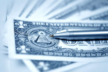 The American money dollars. Bundle of bank notes  and pen Stock Photo - 7239289
