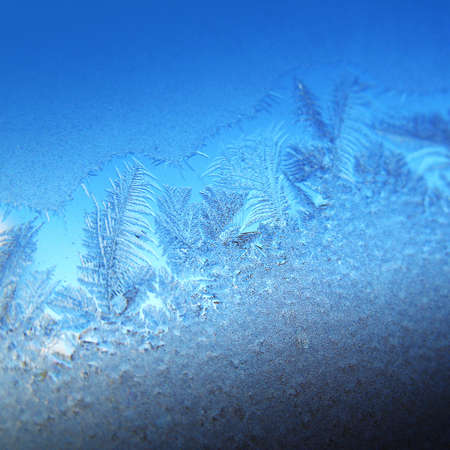 Frosty original  pattern at a winter window glass, natural texture  Stock Photo - 8110689
