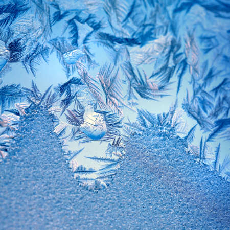 Frosty original  pattern at a winter window glass, natural texture Stock Photo - 8110708