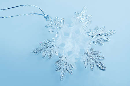 Christmas decorations -  toys silver snowflakes on blue background photo
