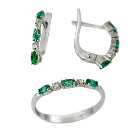 Set of  jewelry with emerald  isolated over white background photo